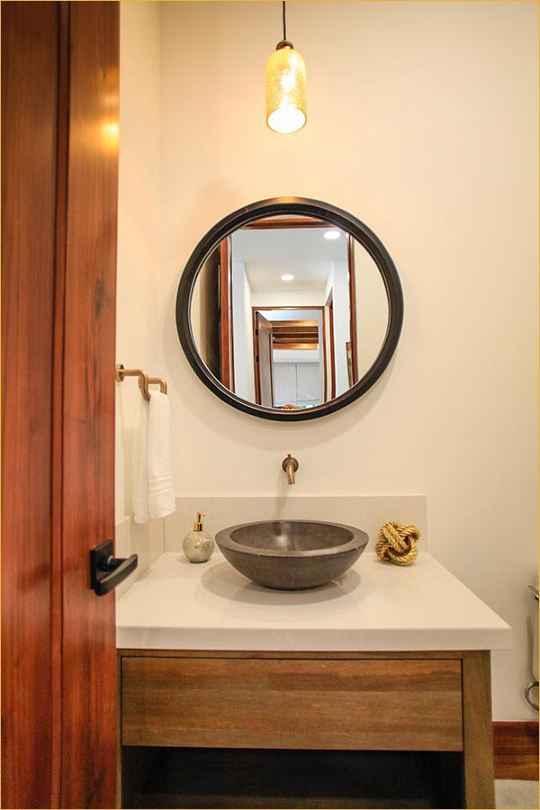 Custom bathrooms plus this half bath for guests.